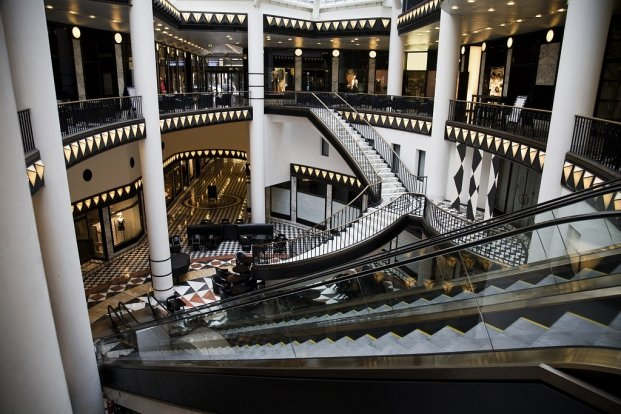 Atrium of a mall with multiple stairs and escalators